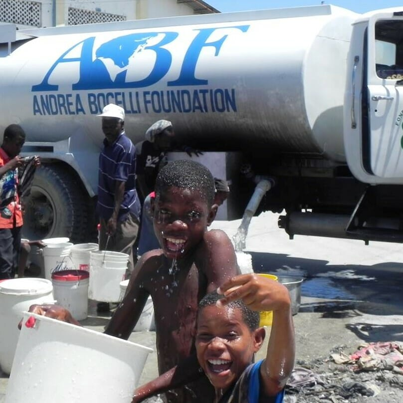 Children playing in front of ABF Water Truck